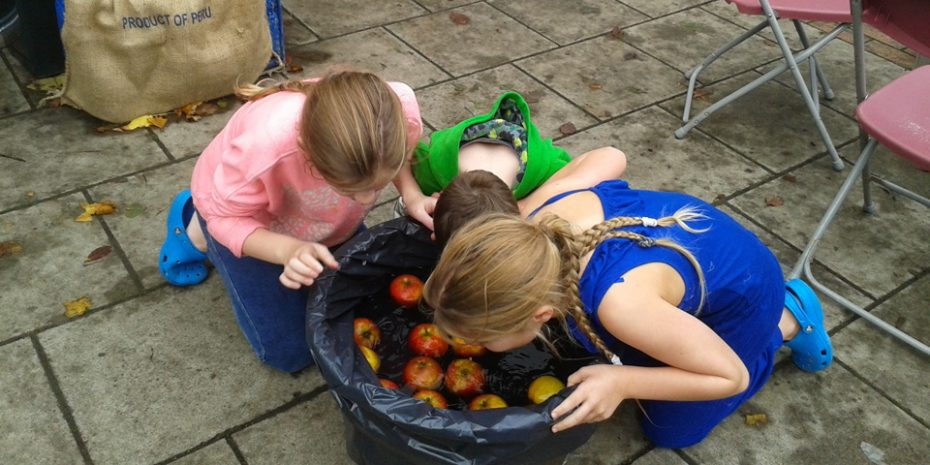 Things to do in the South Hams - Apple bobbing at Dartmouth Food Festival