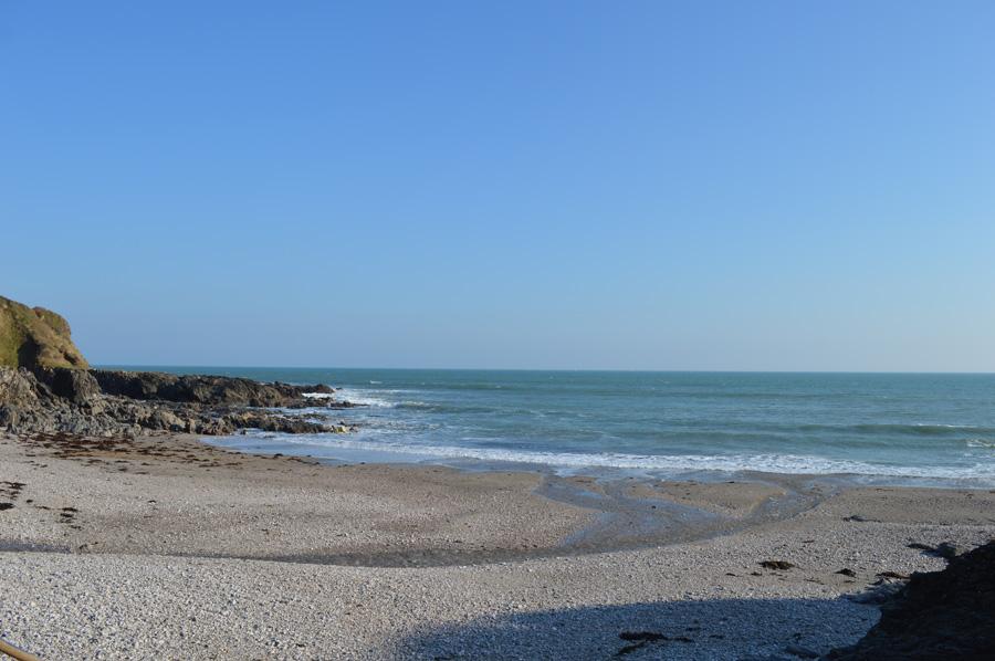A sandy beach between rocky headlands