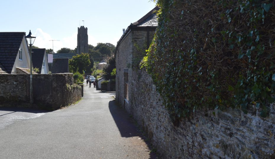 Head towards the church and the Green Dragon