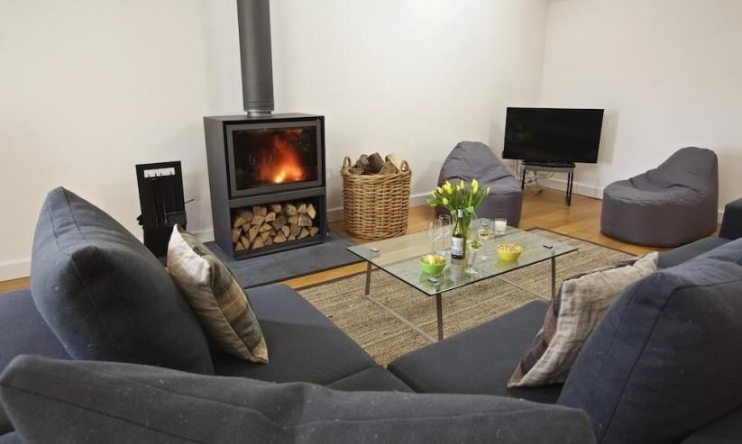 3 Dufour has a charming fireplace in the sitting area.