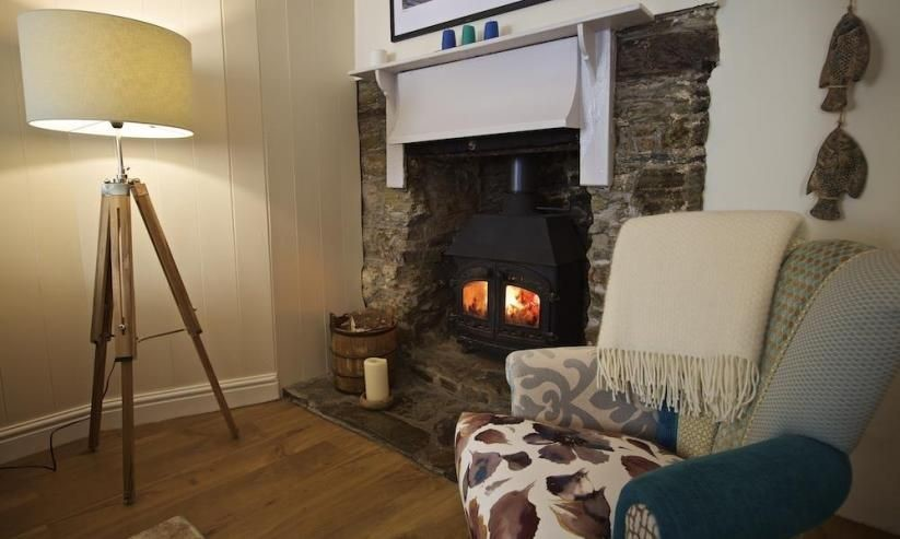 The gorgeous woodburner completes the cosy experience of staying at Cob Cottage