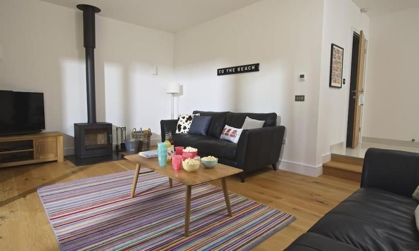 Driftwood in Salcombe is a spacious property with a lovely cosy feel due to its woodburner