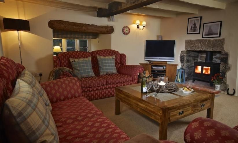 Higher Collaton Cottage has a stunning cosy living area with a beautiful fireplace