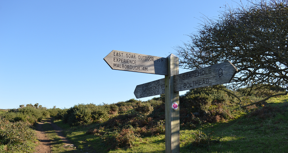 A sign towards the top of the hill by Starehole Bay