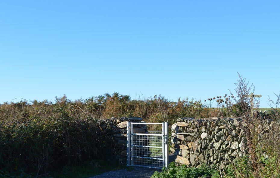 The gate behind the farmhouse