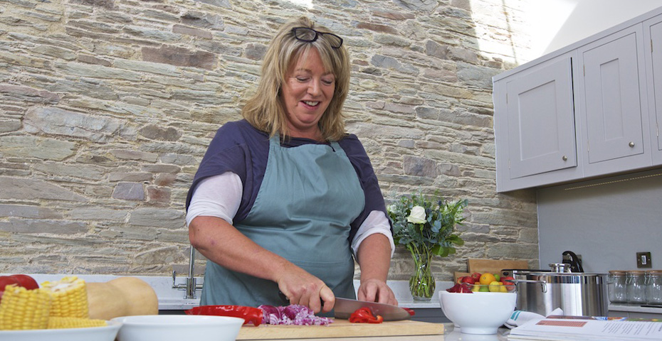 Jane Baxter cooking at a Hillfield Village property