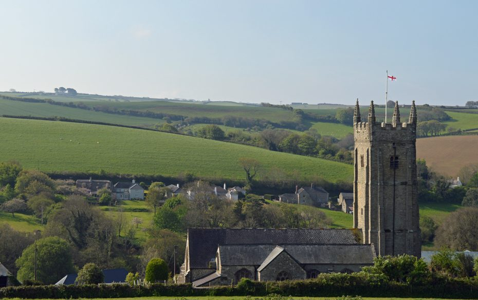 The church peering out the hills in South Pool