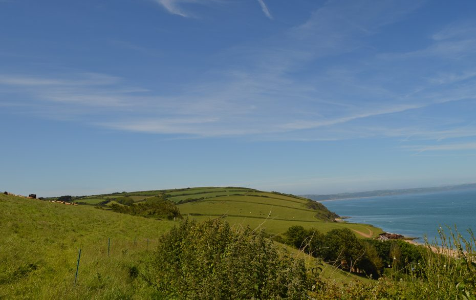 A panoramic view of Start Bay and the surrounding countryside above Hallsands