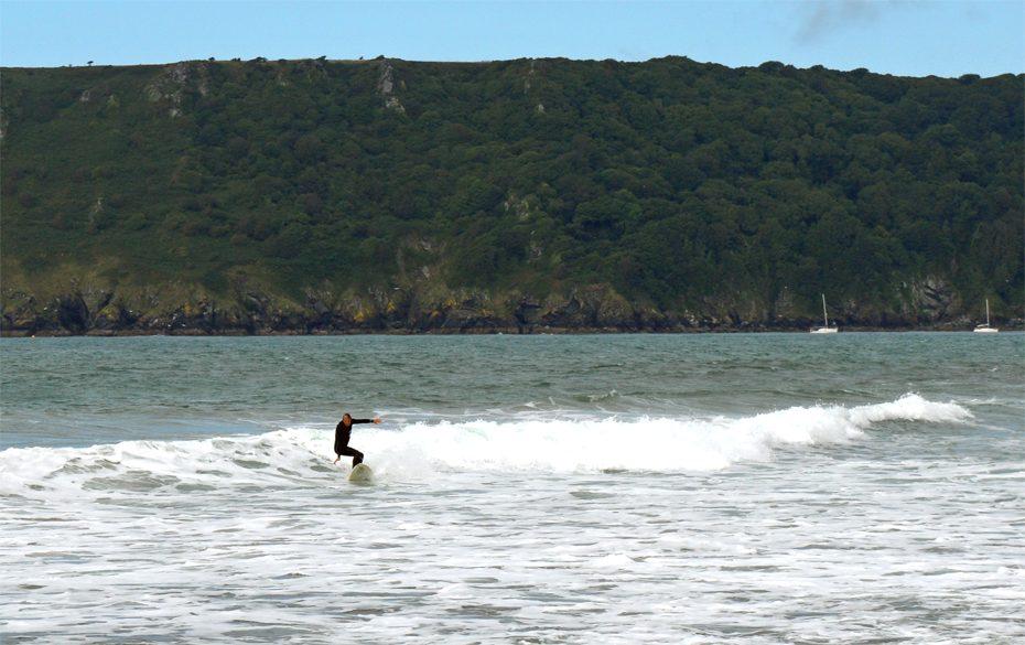 A surfer at Gara Rock Beach