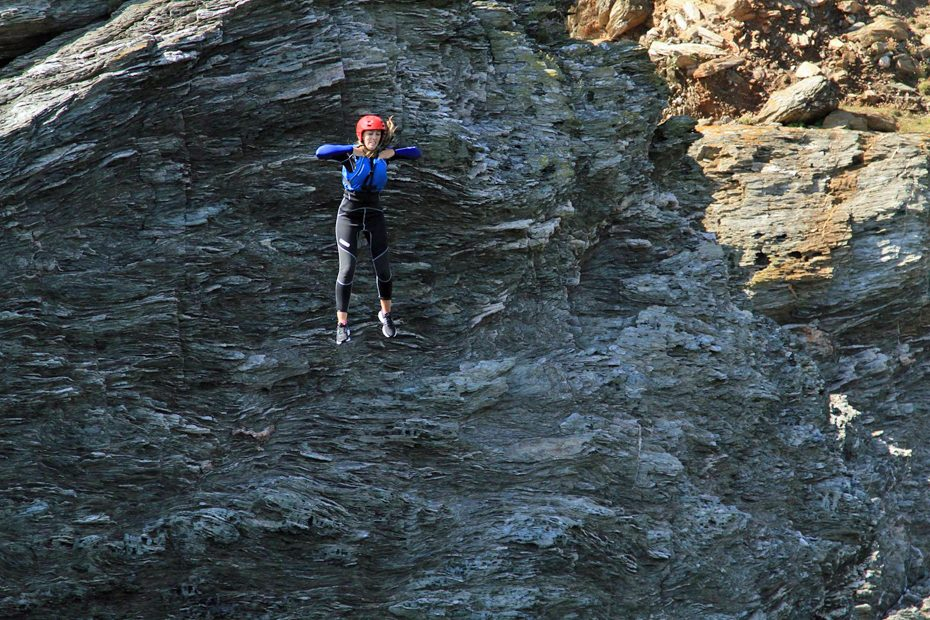 Team member Holly coasteering off Gara Rock