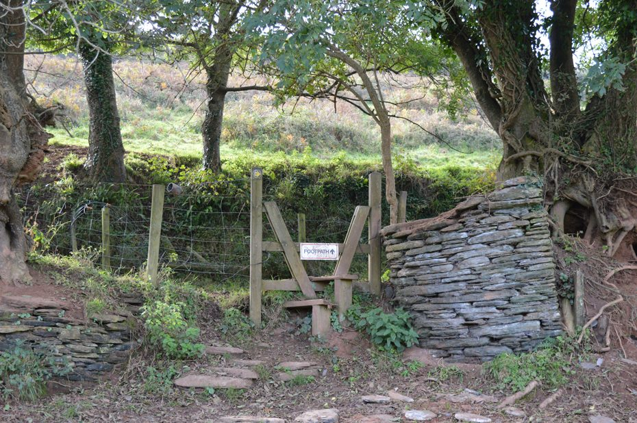 A stile leading to a steep climb in the direction of Thurlestone.