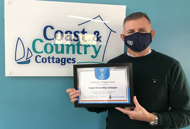 Coast & Country Cottages Managing Director with the Covid-19 Heroes certificate