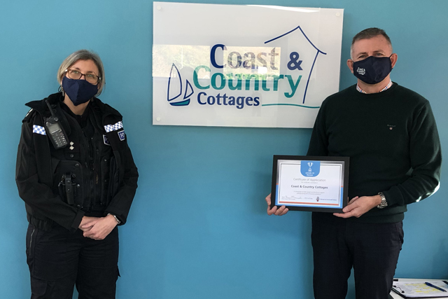 Nicky Baker of Devon and Cornwall Police presenting C&CC with the Covid-19 Heroes Award