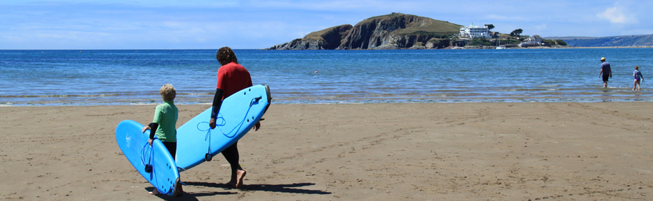 best staycation ideas - family holiday surfing